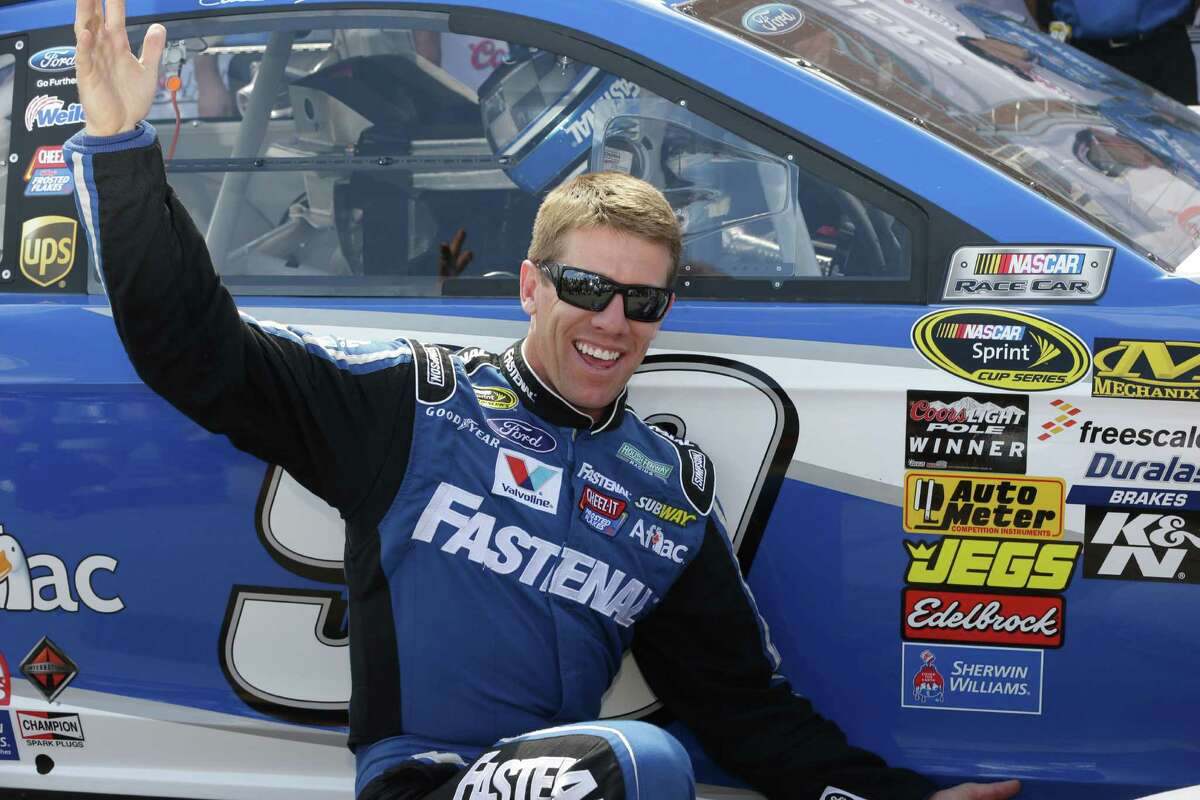 Carl Edwards has reason to smile after winning the pole for Sunday's Sprint Cup race at Brooklyn, Mich., with a qualifying lap of 202.452 mph.