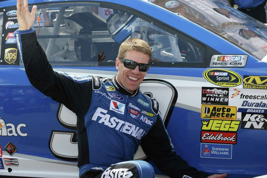 Carl Edwards has reason to smile after winning the pole for Sunday's Sprint Cup race at Brooklyn, Mich., with a qualifying lap of 202.452 mph. Photo: Carlos Osorio, STF / AP