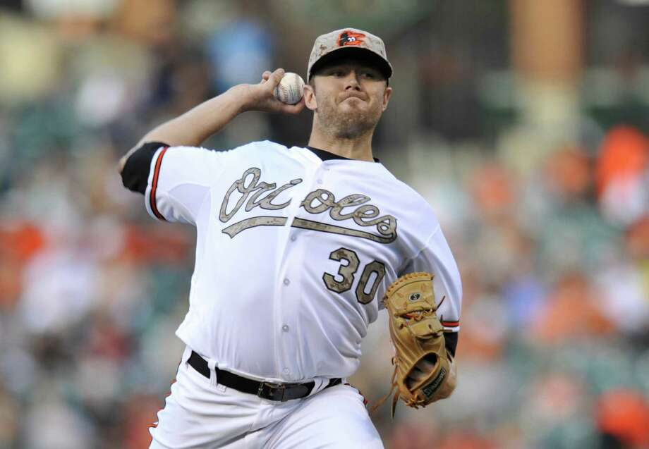 Orioles starter Chris Tillman and three relief pitchers allowed only three hits from the Red Sox.