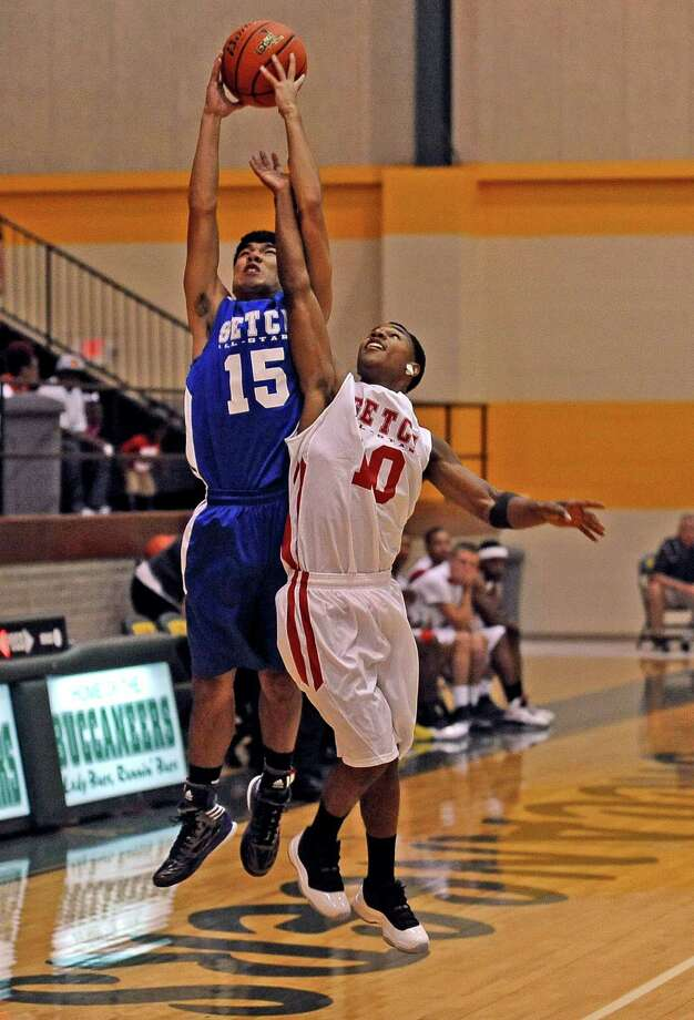 Brandon Pham, #15, of PN-G picks up a pas over the head of Darrion Harper, #10, of Kountze during the Southeast Texas Coaches Association boys basketball all-star game at East Chambers High School on Friday, June 14, 2013. Photo taken: Randy Edwards/The Enterprise Photo: Randy Edwards