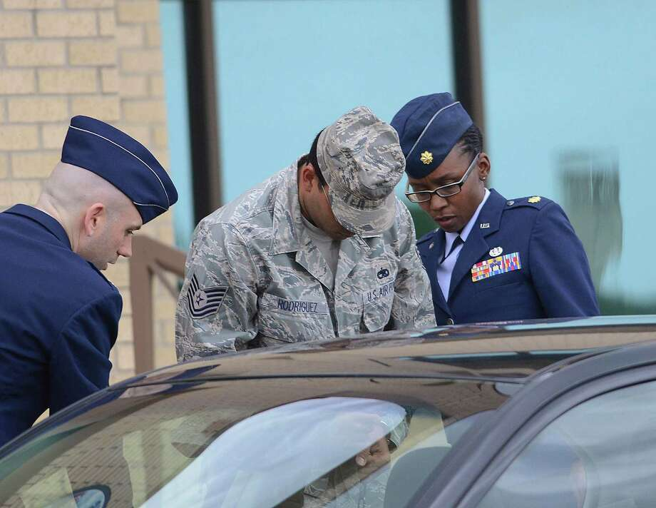 Air Force Tech Sergeant Jaime Rodriguez exits the court at Lackland Air Force Base where he was sentenced for sex crimes on Friday, June 14, 2013. Photo: San Antonio Express-News / San Antonio Express-News