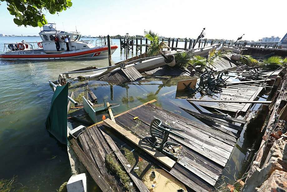 Coast Guard patrol in the area of the dock collapse at Shuckers restaurant in North Bay Village, Florida, on Friday, June 14, 2013, a day after the incident. (Walter Michot/Miami Herald/MCT) Photo: Walter Michot, McClatchy-Tribune News Service