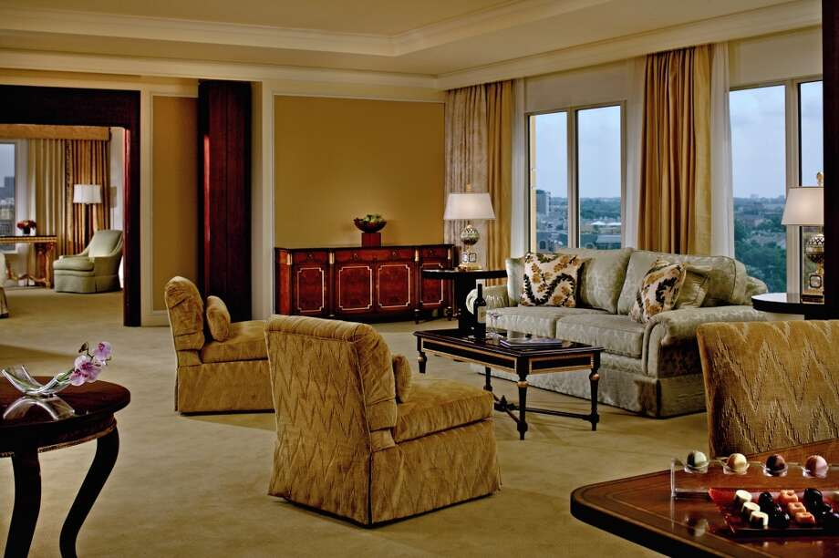 The Ritz-Carlton Suite in Dallas provides traditional furnishings in soft hues along with its sweeping views of downtown Dallas.