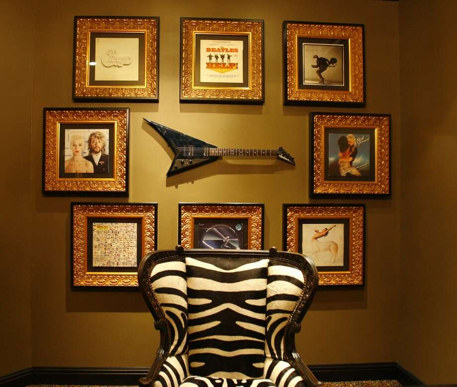 A bold zebra chair and collection of album covers sets the tone for The Rock Star Suite at Houston's Hotel Zaza.