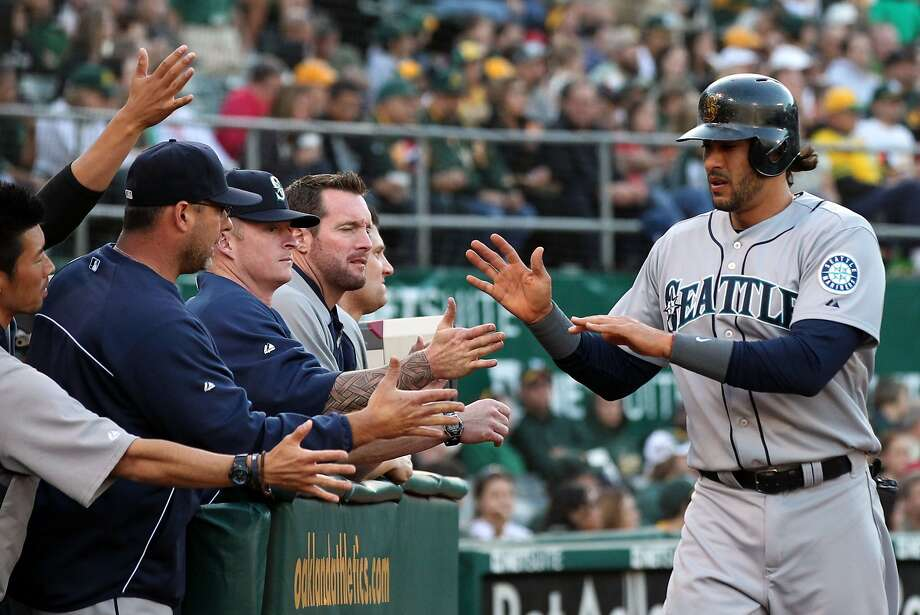 Michael Morse is greeted by Seattle teammates after scoring a run in June during what was mostly a down season. Photo: Lance Iversen, The Chronicle
