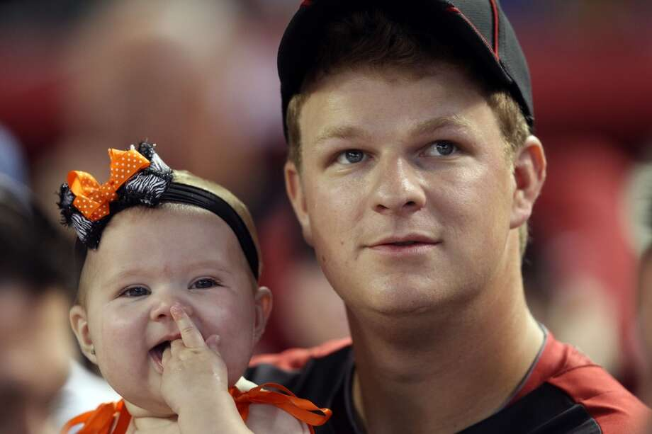 National League All-Star Matt Cain sits with his daughter Hartley during the 2011 Home Run Derby.