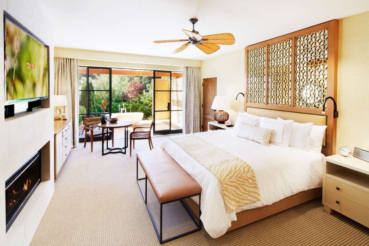 At the focal point of each room is the custom-designed, hand-carved oak headboard above the California King bed.