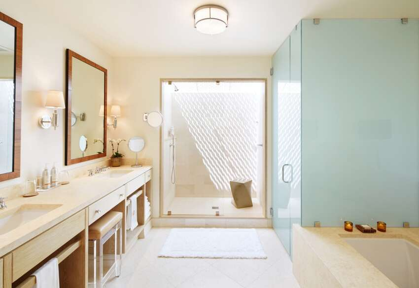 Bathrooms are filled with natural light through the skylit showers.