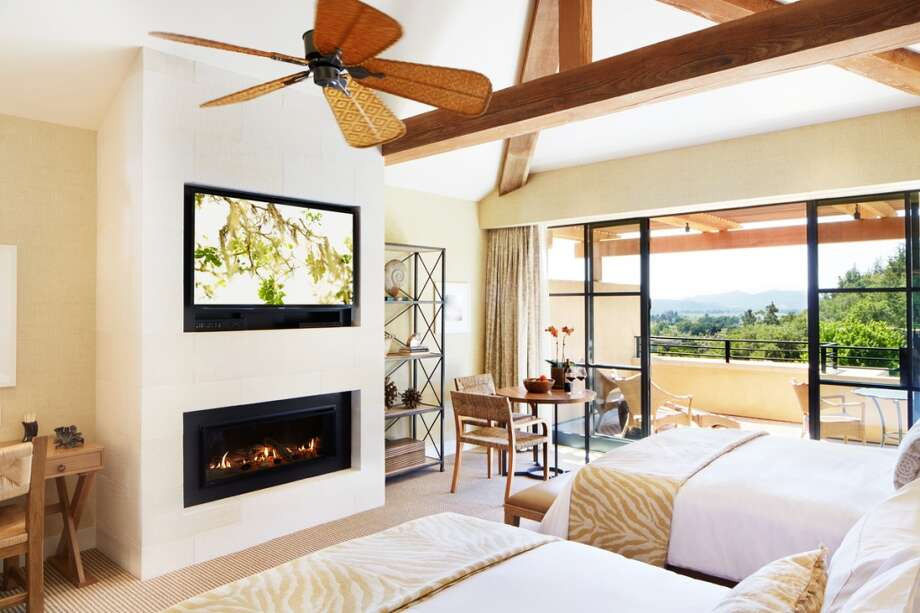 Rooms were  completely reconfigured to create a blank slate for the new sleek look, including  inset fireplaces, light color palette and custom-designed furniture.