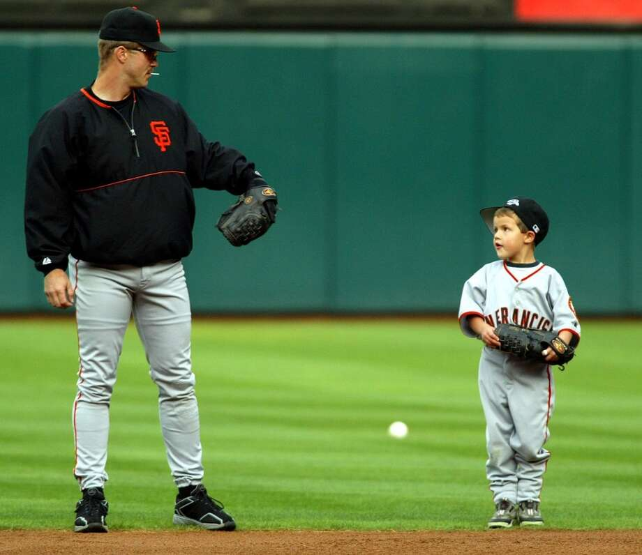Two years later, Kent plays in the infield with Hunter during practice.