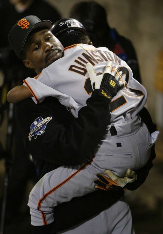 Shawon Dunston holds his son, Shawon Jr., in his arms. Junior now plays in the minor leagues.