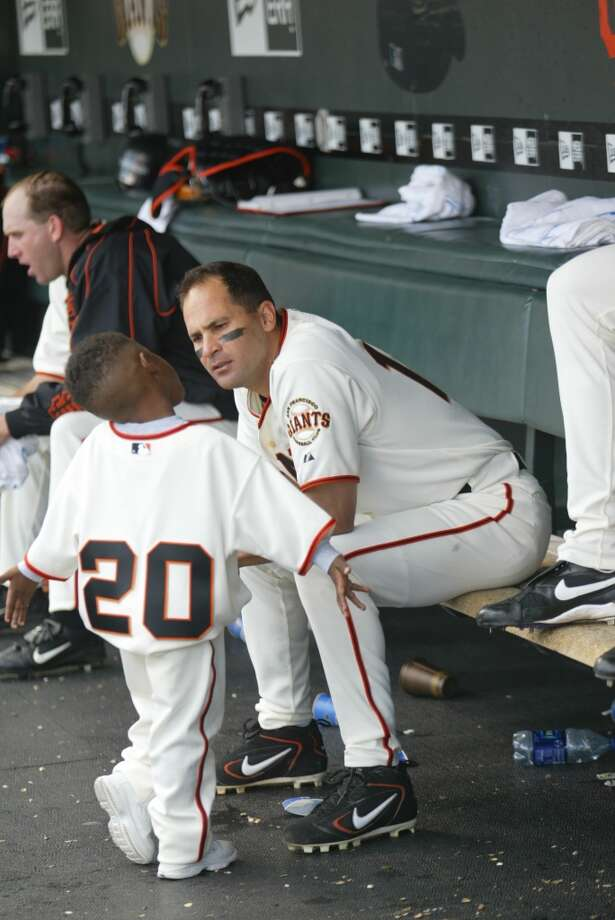 Omar Vizquel chats with teammate Michael Tucker's son during a game against the Arizona Diamondbacks at SBC Park on Father's Day 2005.