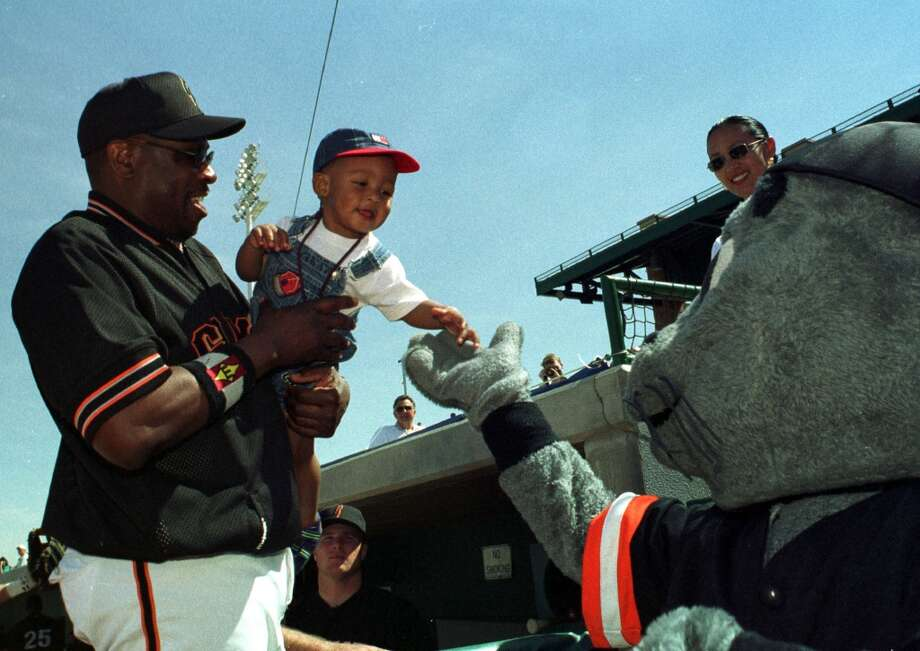 Manager Dusty Baker of the San Francisco Giants introduces his son to the team mascot before the game against the Milwaukee Brewers in 2000.
