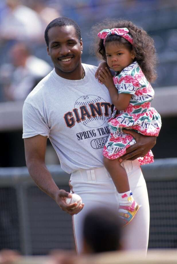 Barry Bonds with daughter, Shikari, during spring training 1994.