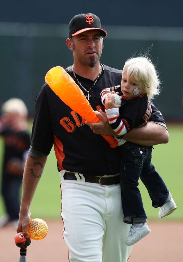 Jeremy Affeldt carries his son Walker during the San Francisco Giants family day activities before the game against the Los Angeles Dodgers at AT&T Park on July 28, 2012.
