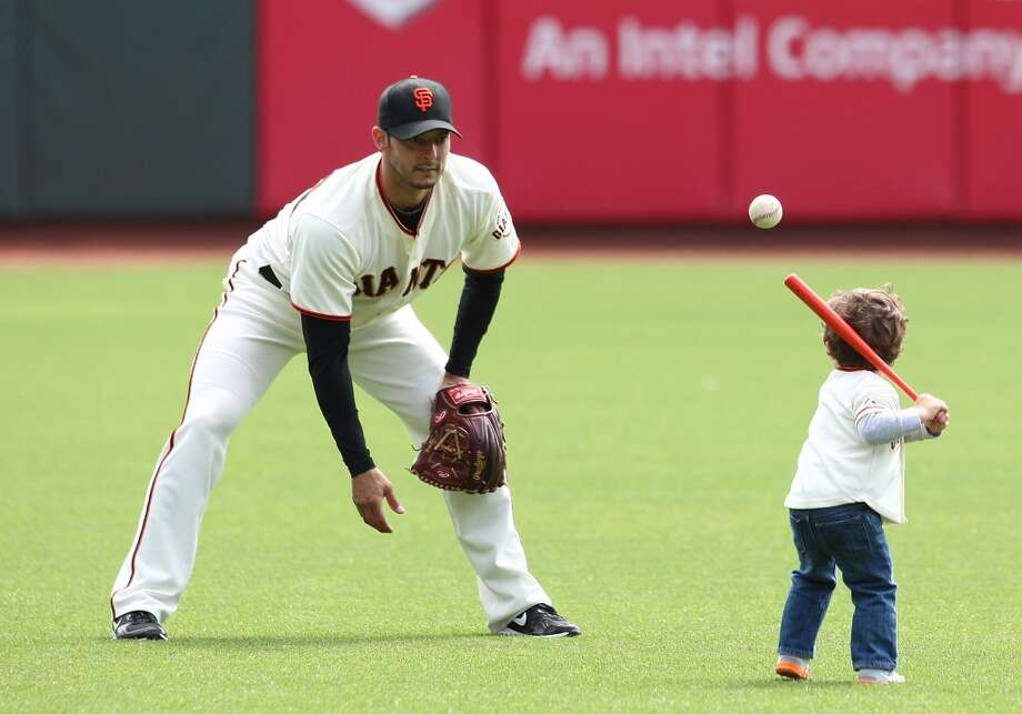 George Kontos pitches to his son during family day activities at AT&T Park on July 28, 2012.