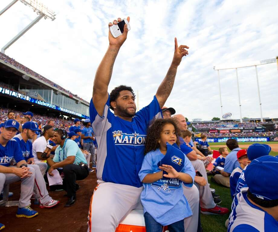 National League All-Star Pablo Sandoval watches the 2012 State Farm Home Run Derby with his daughter at Kauffman Stadium on July 9, 2012 in Kansas City, Missouri.