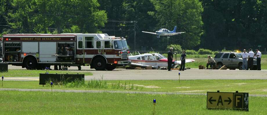 A single-engine plane made an emergency belly landing on Saturday, June 15, 2013 at Danbury Municipal Airport, fire officials said. None of the people aboard the plane were injured. Photo: News Times