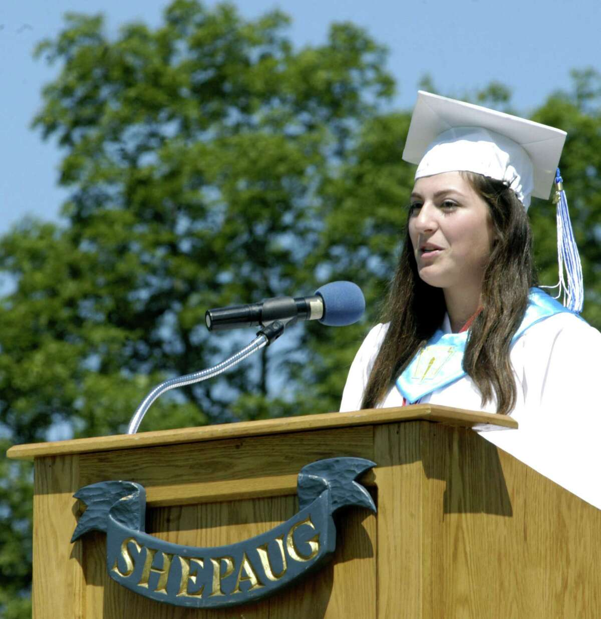 Class of 2013 president Emily Deanne offers her valedictory address to the 500 or so people on hand Saturday during Shepaug Valley High School's commencement ceremony on the school campus in Washington. June 16, 2013