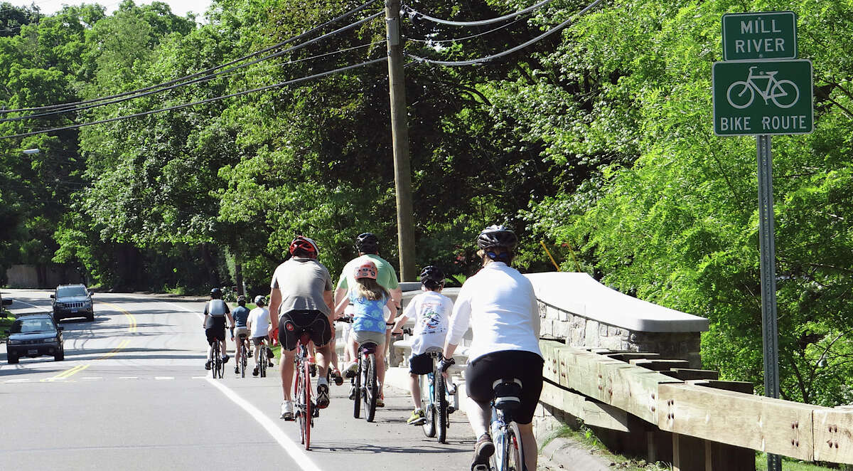 Bicyclists take an inaugural ride on the the new Mill Plain Road bike/walk route after its dedication Saturday morning.