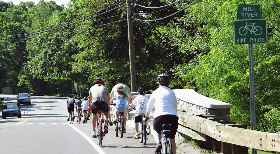 Bicyclists take an inaugural ride on the the new Mill Plain Road bike/walk route after its dedication Saturday morning. Photo: Mike Lauterborn / Fairfield Citizen