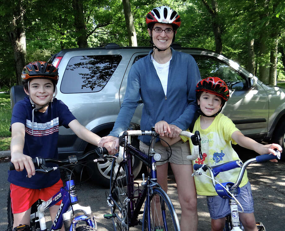 Selectman Cristin McCarthy Vahey with sons, Daniel, 10, and Gabriel, 6, at the ribbon-cutting ceremony for Fairfield's new bike route. Photo: Mike Lauterborn / Fairfield Citizen