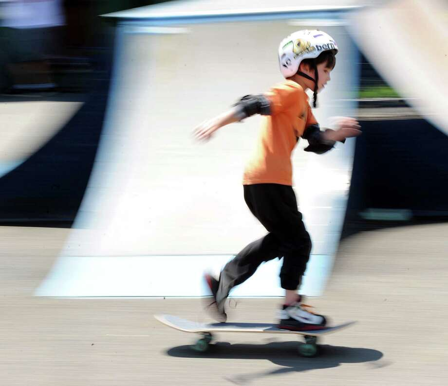 Skateboarder Wyatt Stratton, 7, of Greenwich, is a blur while competing during the 'Go Skate Festival' celebrating the 10-year anniversary of the Skateboarding Park, Greenwich, Saturday, June 15, 2013. Photo: Bob Luckey / Greenwich Time