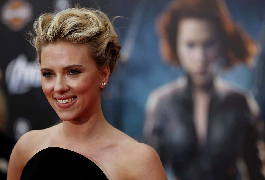 "FILE - In this Wednesday, April 11, 2012 file photo, actress Scarlett Johansson arrives at the premiere of 'The Avengers' in Los Angeles. Actress Scarlett Johansson is suing a French publishing house over a novel that uses her name and image and explores the challenges of being beautiful. The JC Lattes publishing house said Friday June 14, 2013, that a lawsuit was filed last week about Gregoire Delacourt's book ""The First Thing We Look At."" (AP Photo/Matt Sayles, File) Photo: Matt Sayles"