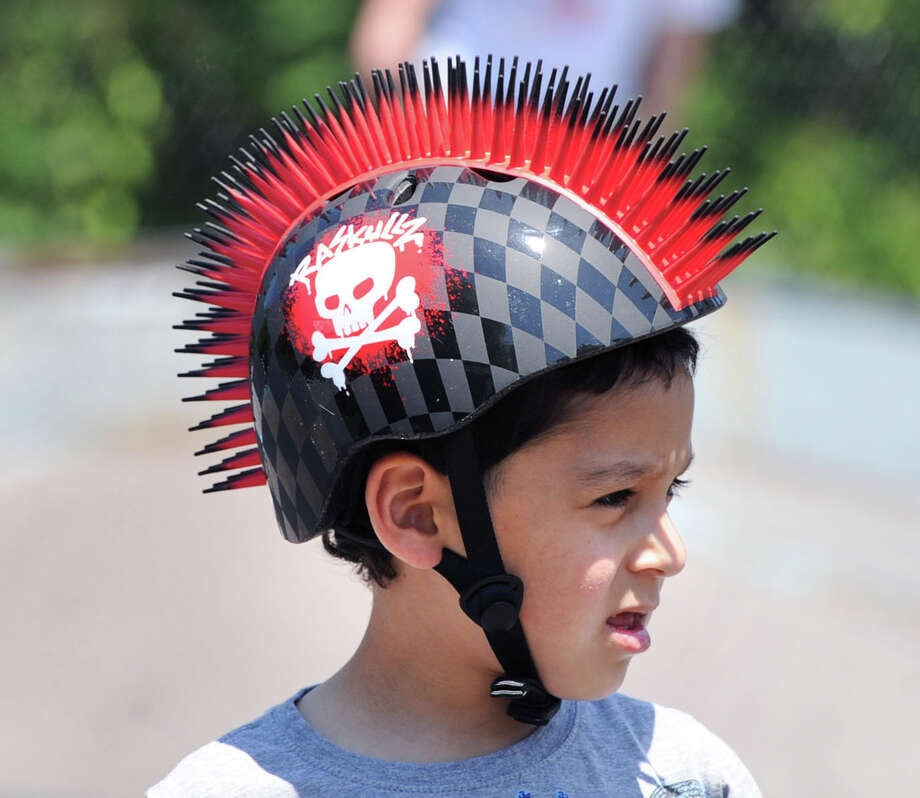 Christian De Souza, 7, of Stamford, wears a spikey skull & cross bones helmet during the 'Go Skate Festival' celebrating the 10-year anniversary of the Skateboarding Park, Greenwich, Saturday, June 15, 2013. Photo: Bob Luckey / Greenwich Time
