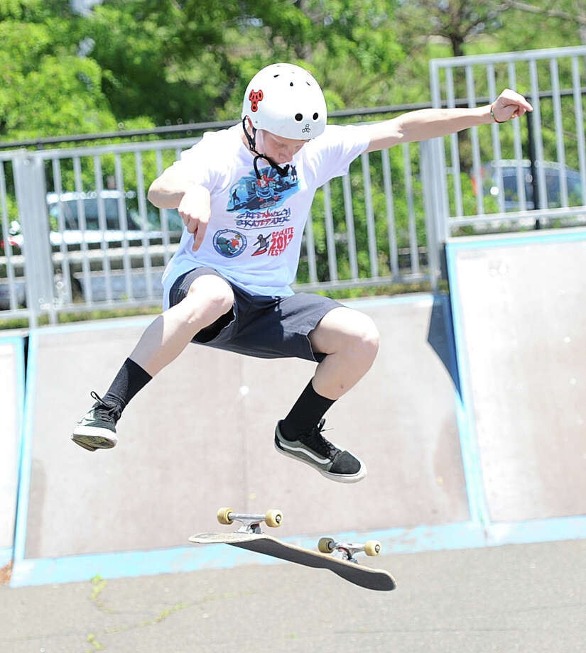 Lucas Perez, 15, of Cos Cob, busts a move during the 'Go Skate Festival' celebrating the 10-year anniversary of the Skateboarding Park, Greenwich, Saturday, June 15, 2013. Photo: Bob Luckey / Greenwich Time