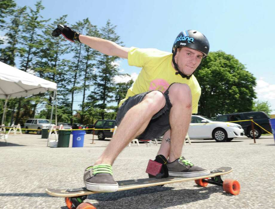 Gary Enright, 21, of Port Chester, N.Y., gives a skating demonstration on his longboard during the 'Go Skate Festival' celebrating the 10-year anniversary of the Skateboarding Park in Greenwich, Saturday, June 15, 2013. Photo: Bob Luckey / Greenwich Time