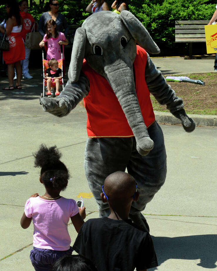 Barnum Festival mascot Spirit the Elephant waves to children as the Wing Ding Parade makes its way through Beardsley Zoo in Bridgeport, Conn. on Saturday June 15, 2013. Photo: Christian Abraham / Connecticut Post