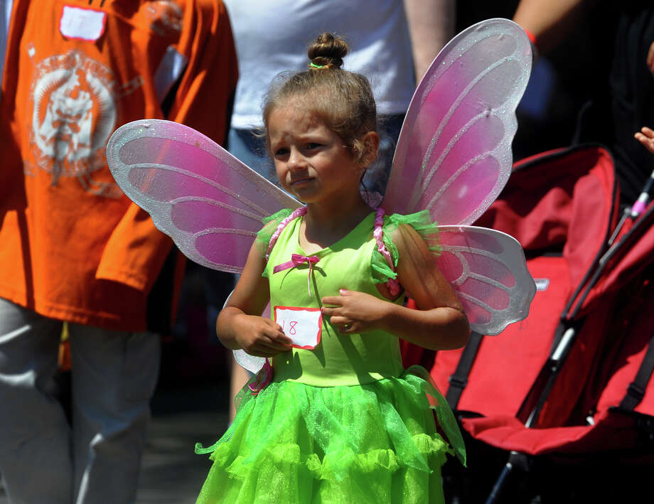 Salina Velasquez, 4, is dressed up as Tinkerbell as she takes part in the Barnum Festival's Wing Ding Parade at Beardsley Zoo in Bridgeport, Conn. on Saturday June 15, 2013. Photo: Christian Abraham / Connecticut Post