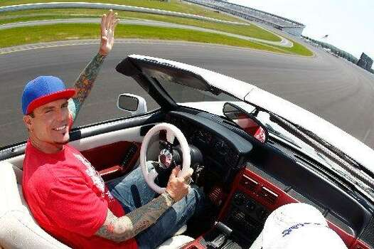 Vanilla Ice was said to have died in a car crash but he is alive and well. (Photo by Jeff Zelevansky/Getty Images for NASCAR)
