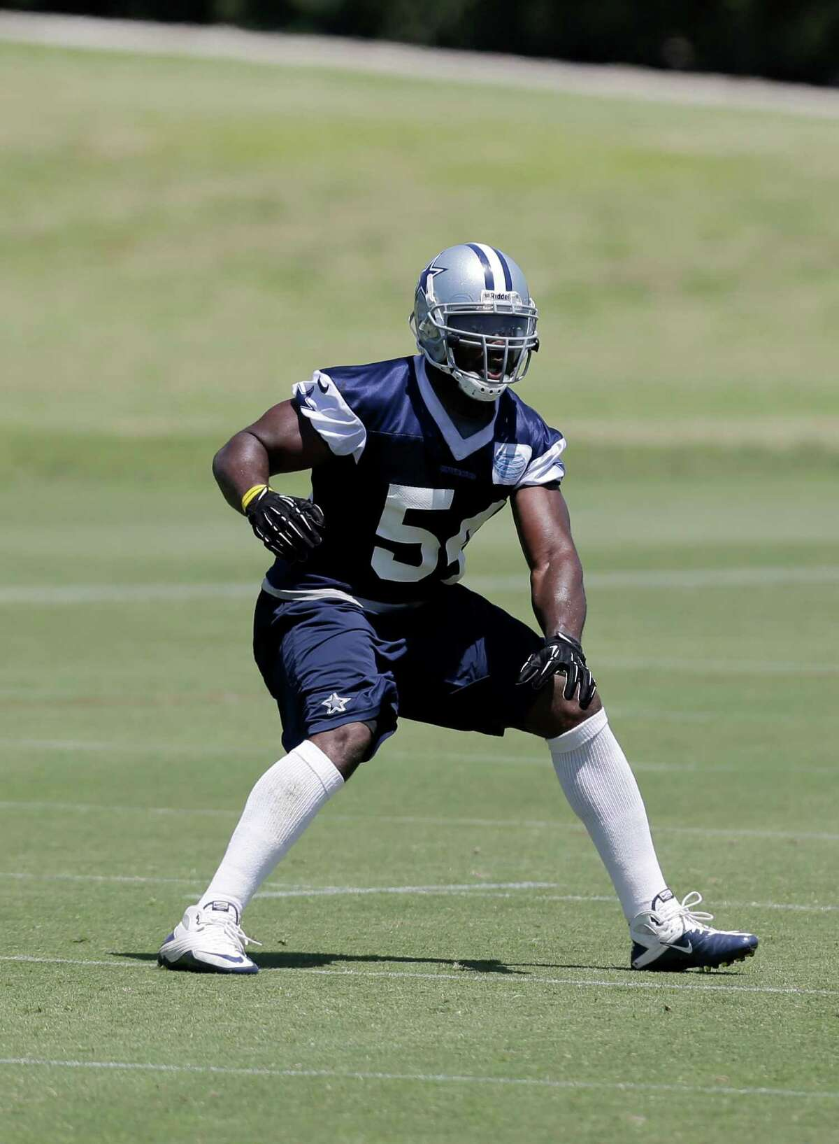 Dallas Cowboys linebacker Bruce Carter (54) defends at the line of scrimmage as the team runs a play during their NFL football minicamp on Thursday, June 13, 2013, in Irving, Texas. (AP Photo/Tony Gutierrez)