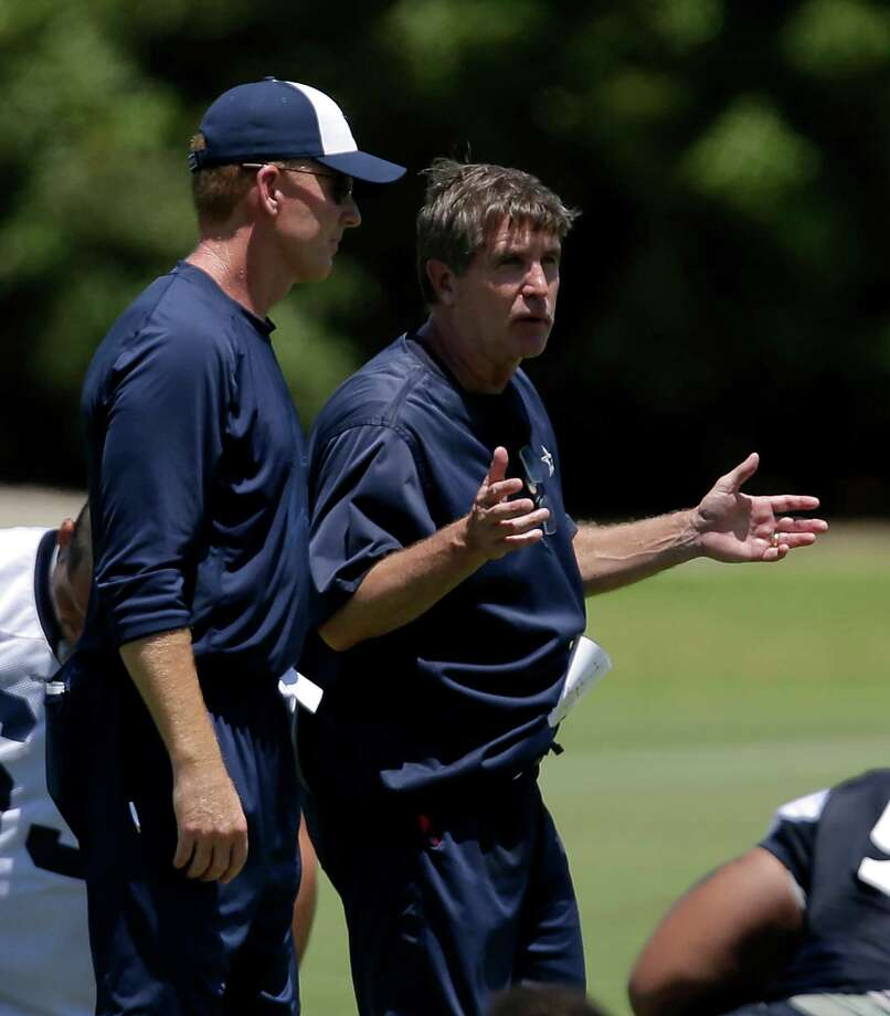 Dallas Cowboys head coach Jason Garrett, left, and offensive coordinator Bill Callahan, right, talk as the team stretches at the end of a workout during their NFL football minicamp on Thursday, June 13, 2013, in Irving, Texas. (AP Photo/Tony Gutierrez) Photo: Tony Gutierrez, Associated Press / AP