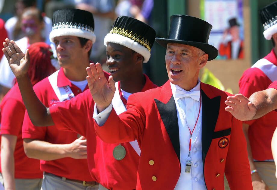 Barnum Festival's Ringmaster John F. Stafstrom, Jr. walks in the Wing Ding Parade in Beardsley Zoo in Bridgeport, Conn. on Saturday June 15, 2013. Photo: Christian Abraham / Connecticut Post