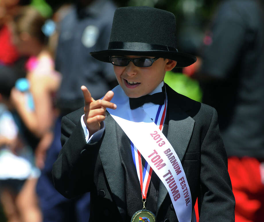 Sebastian Machado, 10, this year's Barnum Festival Tom Thumb, walks in the Wing Ding Parade in Beardsley Zoo in Bridgeport, Conn. on Saturday June 15, 2013. Photo: Christian Abraham / Connecticut Post
