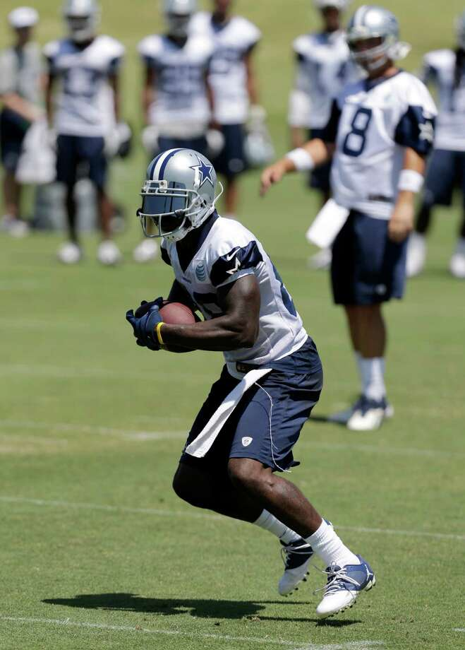 Dallas Cowboys wide receiver Dez Bryant (88) runs a route as the team runs  play during their NFL football minicamp on Thursday, June 13, 2013, in Irving, Texas. (AP Photo/Tony Gutierrez) Photo: Tony Gutierrez, Associated Press / AP