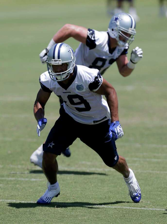 Dallas Cowboys wide receiver Miles Austin (19) sprints from the line of scrimmage as the team runs a play during their NFL football minicamp on Thursday, June 13, 2013, in Irving, Texas. (AP Photo/Tony Gutierrez) Photo: Tony Gutierrez, Associated Press / AP