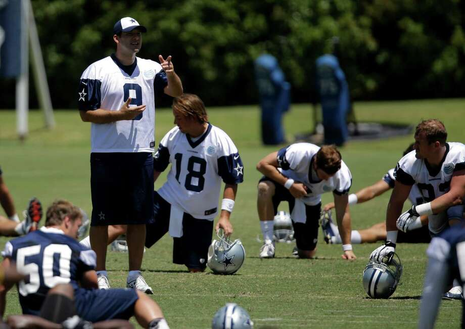 Dallas Cowboys quarterback Tony Romo (9) motions to a teammate as the team stretches at the end of a workout during their NFL football minicamp on Thursday, June 13, 2013, in Irving, Texas. (AP Photo/Tony Gutierrez) Photo: Tony Gutierrez, Associated Press / AP