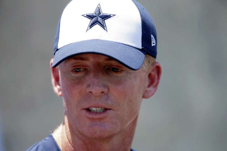 Dallas Cowboys head coach Jason Garrett listens to a question at a news conference after a team workout during their NFL football minicamp on Thursday, June 13, 2013, in Irving, Texas. (AP Photo/Tony Gutierrez) Photo: Tony Gutierrez, Associated Press / AP