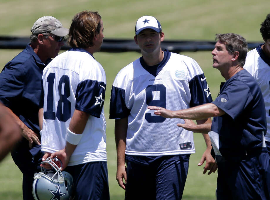 Dallas Cowboys quarterbacks Kyle Orton (18), Tony Romo (9) and quarterbacks coach Wade Wilson, left, talk with offensive coordinator Bill Callahan, right, as the team takes in a practice during their NFL football minicamp on Thursday, June 13, 2013, in Irving, Texas. (AP Photo/Tony Gutierrez) Photo: Tony Gutierrez, Associated Press / AP
