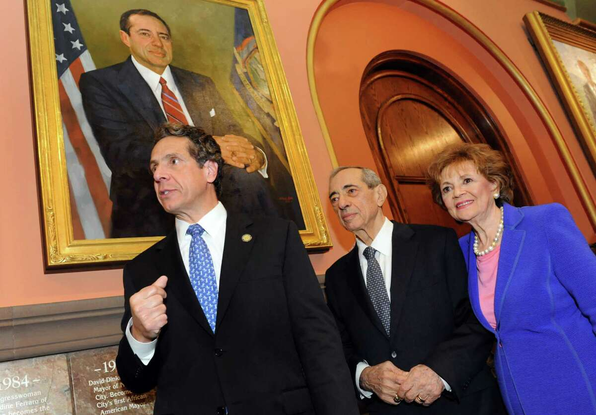 Gov. Andrew Cuomo joins his father, former Gov. Mario Cuomo, and mother, former First Lady Matilda Cuomo, as the elder Cuomo's portrait is revealed in the Hall of Governors on Saturday, June 15, 2013, at the Capitol in Albany, N.Y. (Cindy Schultz / Times Union)