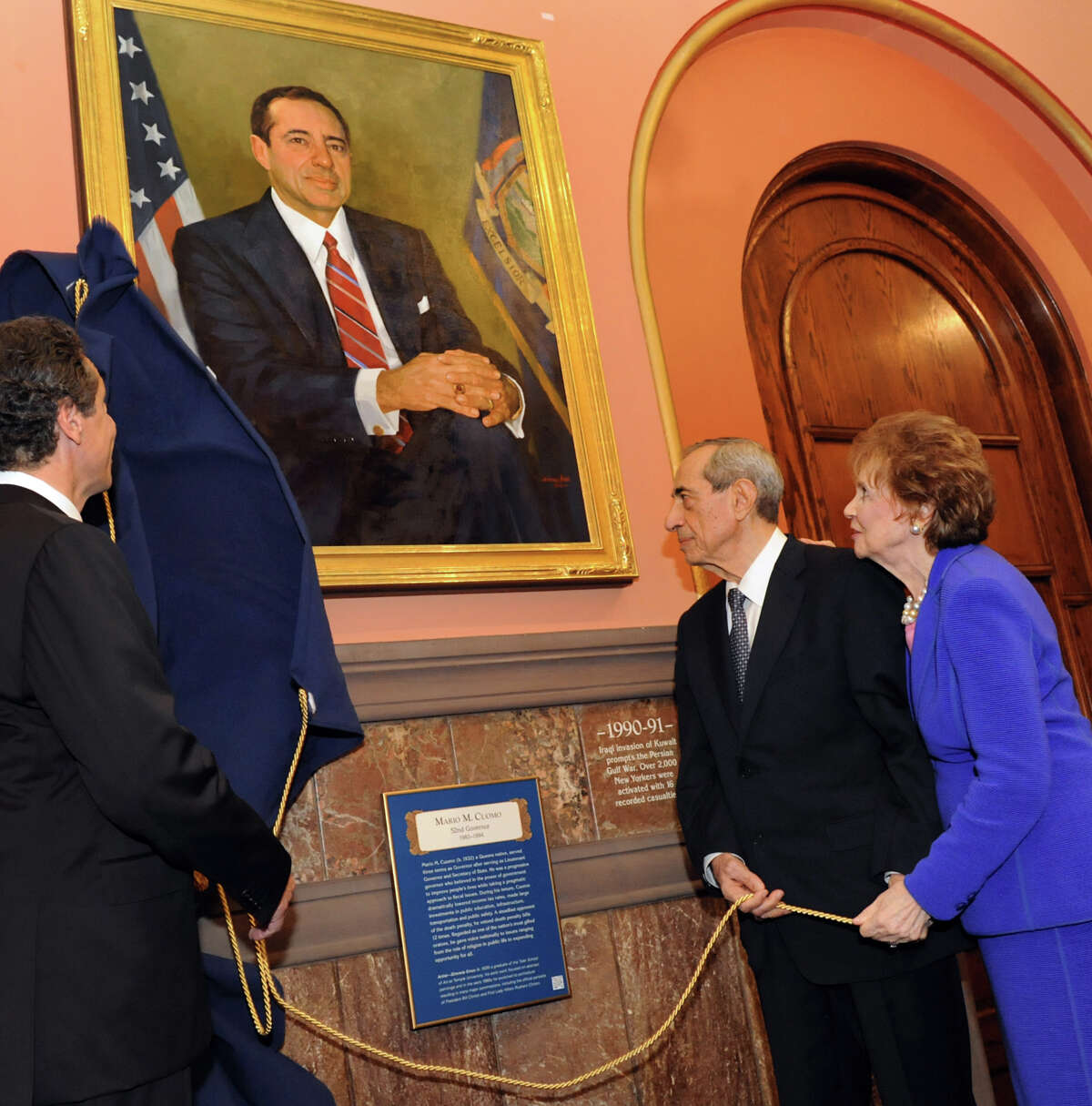Gov. Andrew Cuomo, left, joins his father, former Gov. Mario Cuomo, and mother, former First Lady Matilda Cuomo, as the elder Cuomo's portrait is revealed in the Hall of Governors on Saturday, June 15, 2013, at the Capitol in Albany, N.Y. (Cindy Schultz / Times Union)