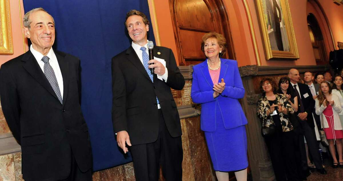 Gov. Andrew Cuomo, center, joins his father, former Gov. Mario Cuomo, left, and mother, former First Lady Matilda Cuomo, before the elder Cuomo's portrait is revealed in the Hall of Governors on Saturday, June 15, 2013, at the Capitol in Albany, N.Y. (Cindy Schultz / Times Union)