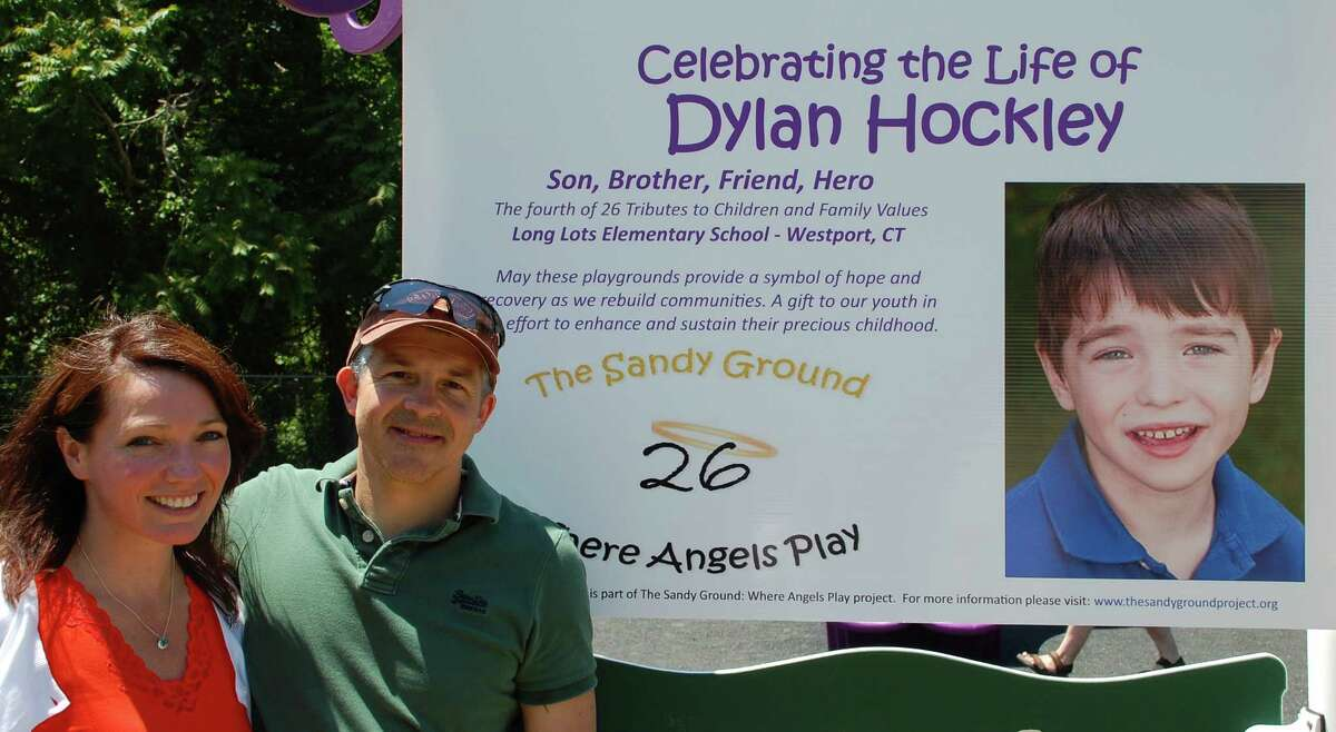 Nicole and Ian Hockley, parents of 6-year-old Dylan Hockley, who died in the Sandy Hook School shooting lasy year, at Long Lots School on Saturday for the dedication of the playground in the boy's memory. WESTPORT NEWS, CT 6/15/13