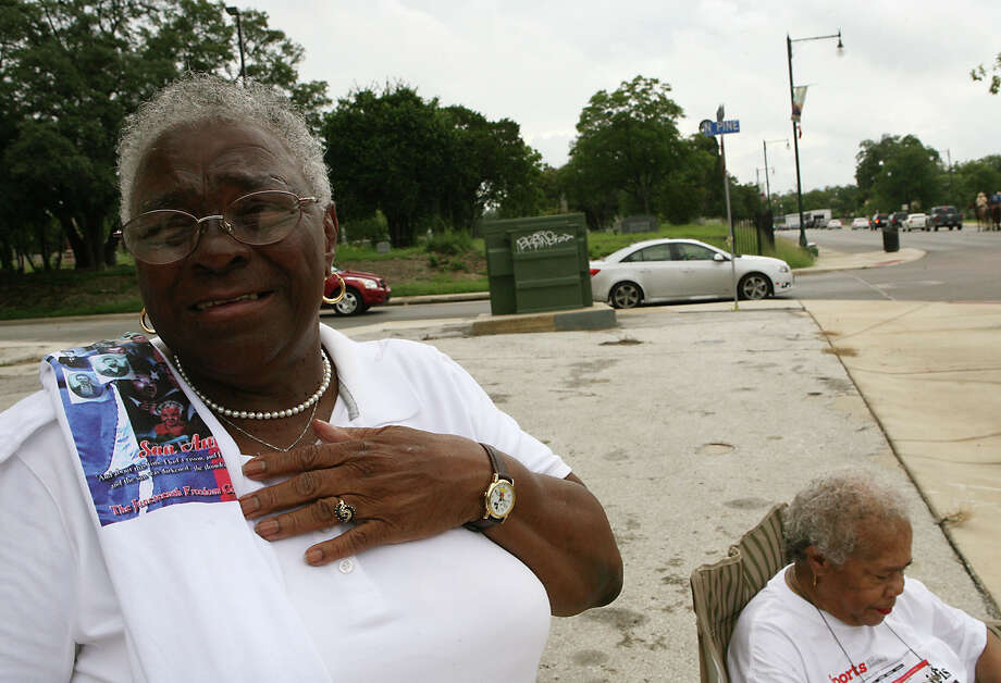 Billie Wilson gets emotional as the end of the 15th Annual Juneteenth Freedom Parade passes by June 15, 2013 on E. Commerce Street. Wilson says it feels really good to see the parade, put on by the Juneteenth Freedom Coalition, going on. Photo: Cynthia Esparza, For San Antonio Express-News / For San Antonio Express-News