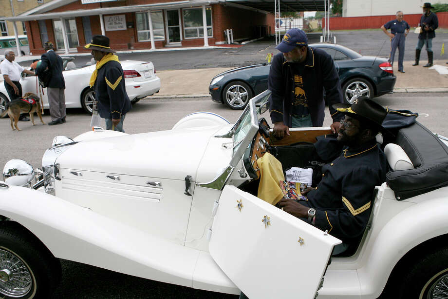 Trooper Eugene Wilson waits in his 1929 Mercedes Roadster for the 15th Annual Juneteenth Freedom Parade to start June 15, 2013. Wilson is part of the Bexar County Buffalo Soldiers. Photo: Cynthia Esparza, For San Antonio Express-News / For San Antonio Express-News