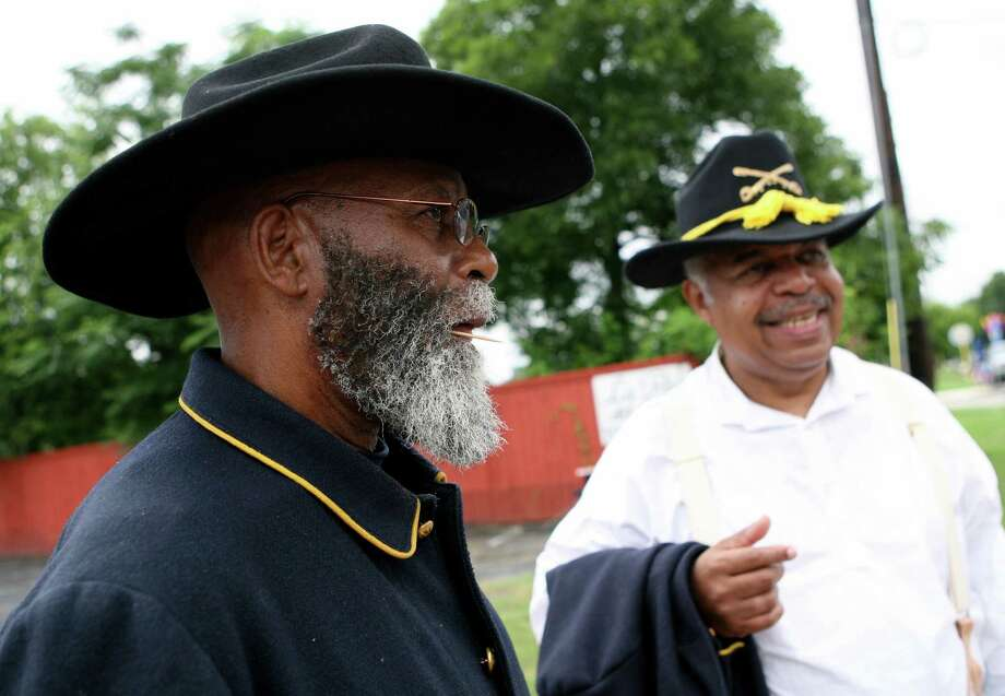 Buffalo Soldiers R. Russell (left) and Dwight Zeigler mingle June 15, 2013 before the 15th Annual Juneteenth Freedom Parade. Photo: Cynthia Esparza, For San Antonio Express-News / For San Antonio Express-News